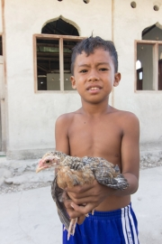 Bajo kid and his chicken